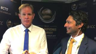 Shaun Pollock gets one back over Kumar Sangakkara
