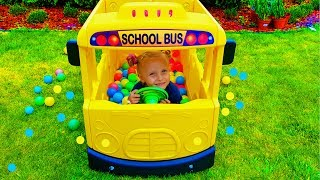 Little girl pretend play driver of School bus / Wheels on the us