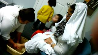 Yahweh servant washing Suzy's feet