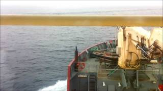 Vessel Hitting the Wake of a very Large cargo ship (Ebba Maersk)