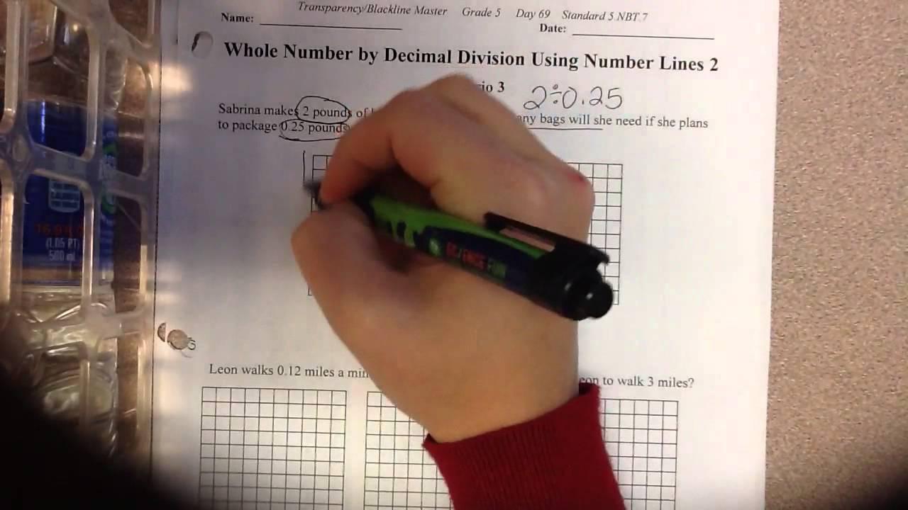 Dividing decimals using number lines