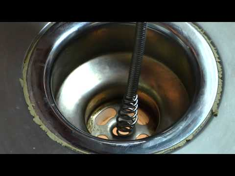How to Work a Snake for a Clog in a Sink : Home Sweet Home Repair