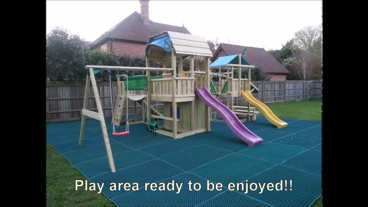 Jungle Gym climbing frames being installed with safety rubber mats ...