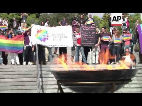 Activists protest Russian law banning homosexual propaganda ahead of flame handover
