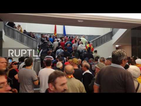 Macedonia: Tripods hurled at opposition MPs as nationalists storm parliament