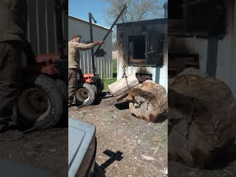 Homemade outdoor wood boiler log lifter