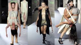 Models walk the runway carrying other models in bizarre Rick Owens show