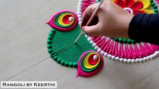 Simple peacock feather rangoli designs with colours l rangoli design l rangoli by keerthi l रंगोली