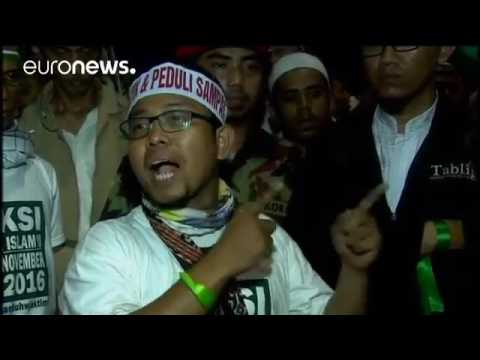 Mass rally against Jakarta's governor turns violent   world