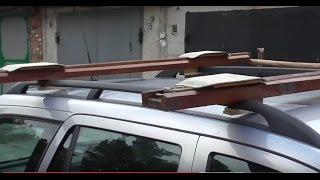 Моторная лодка на рейлингах авто. Приспособление для погрузки и выгрузки.