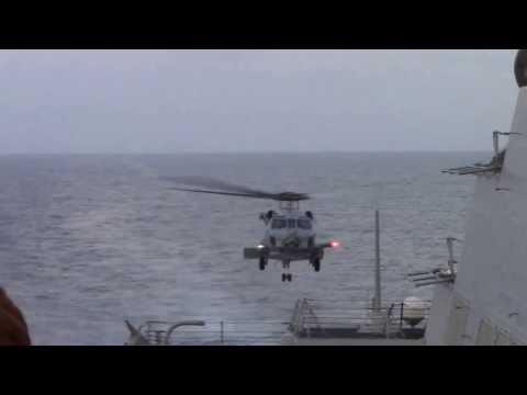 U.S. Navy Helicopter Takes Off from USS Kidd (DDG 100) in Search of MH370