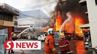 Road closed for rescuers battling house fire in Penang