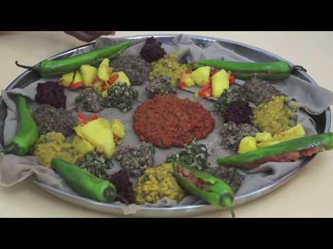 Ethiopian Food - Beyeyanetu a vegan platter of food on injera - miser gomen wot enjera sinig