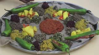Ethiopian Food - Beyeyanetu a vegan platter of food on injera - miser - gomen - wot - enjera - sinig