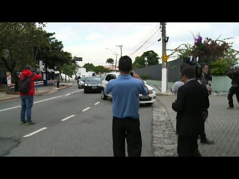 Car carrying ex-Brazil president Temer arrives at police station