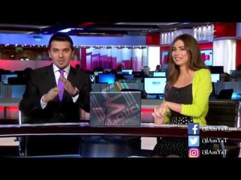 فضيحة  مذيعة مع زمليها بالبث المباشر على قناة  MBC  وطلب جريء ان يحملها