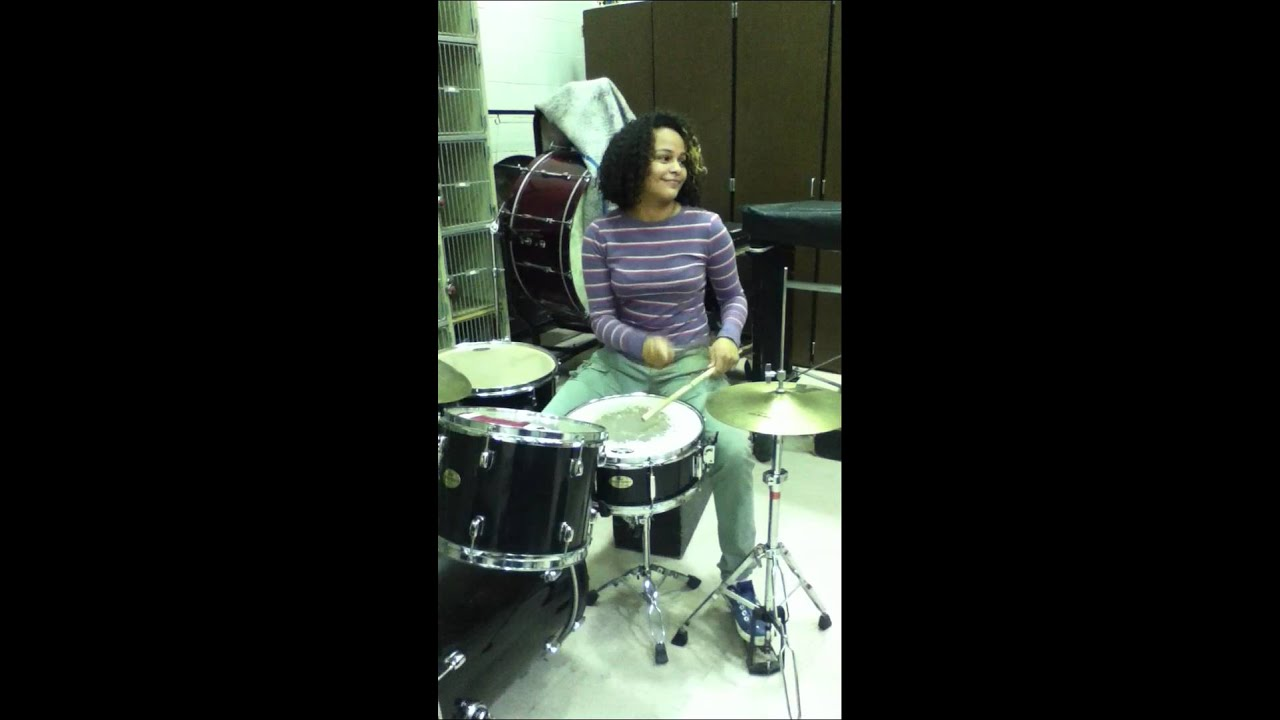 girl playing drums - 607×1080