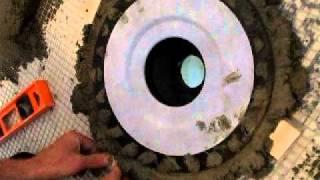 setting kerdi drain in deck mud