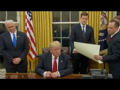 Trump signs first executive order targeting Obamacare regulations
