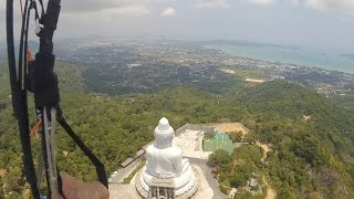Crazy paragliding take off in rotor near Phuket Big Budda.