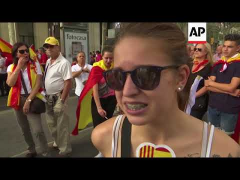 Thousands of Catalans march in Barcelona in support of unity