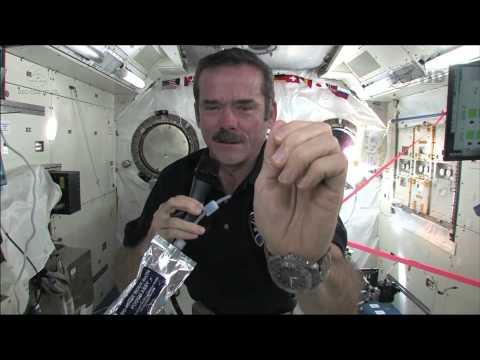 Chris Hadfield demonstrates how astronauts wash their hands in zero-g