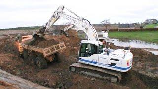 Volvo EC220D Excavator Loading Volvo A25 Dumpers
