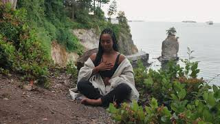 A Woman Doing Breathing Exercises Outdoors
