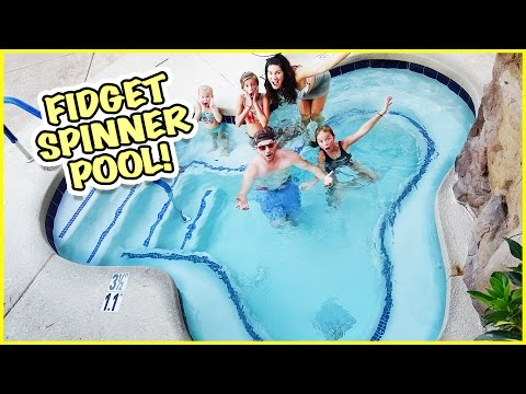 GIANT POOL SHAPED FIDGET SPINNER! HUMAN SPIN TRICKS!