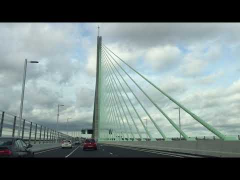 Travelling across Mersey Gateway bridge entering Liverpool on opening day