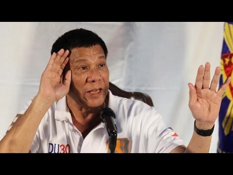 Hit Man Recalls Violent Past of Philippine President as Wave of Killings Raise Human Rights Concerns