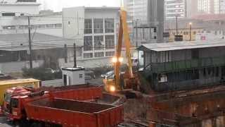 CAT 320D Excavator Long Boom in the Rain
