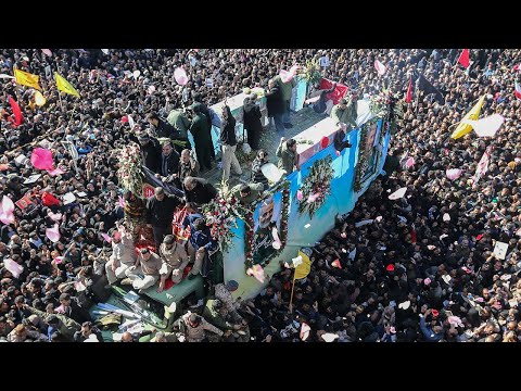 video: More than 60 people die in stampede at Qassim Soleimani's funeral as Iran warns of attack on Israel