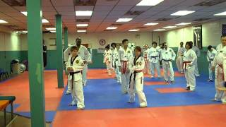 Tae Kwon Do class, balance drills with ankle weights