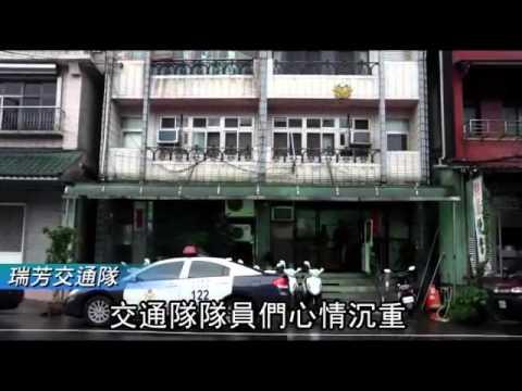 交警殉職弟噙淚棒靈位--蘋果日報 20140612