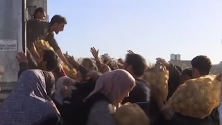 Chaotic scenes in Mosul  Scuffles for food, warning shots as govt aid arrives
