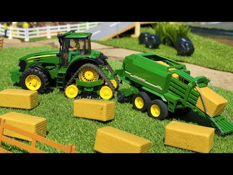 BRUDER tractor farming toys | John Deere haybale action video for kids!