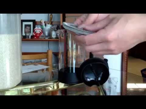Taking apart French Press for cleaning.