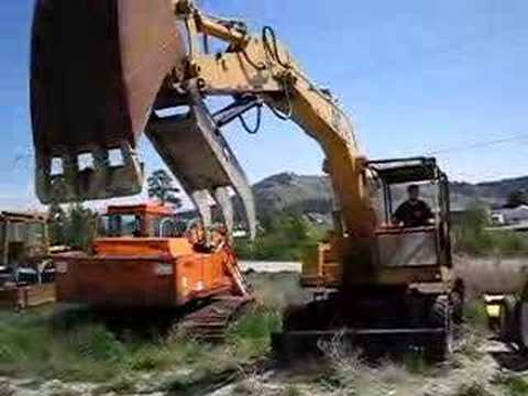 CAT 206 Wheel Excavator With Thumb