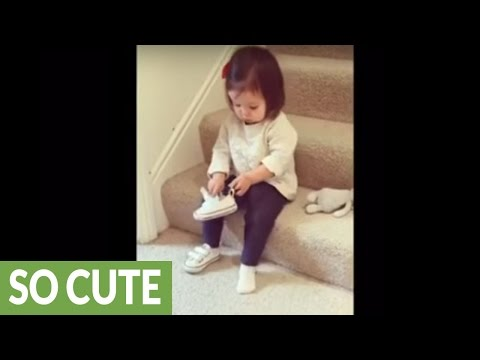 Tiny toddler gets ready all by herself!