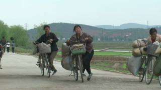 Countryside and street in North Korea-bicycles 1 HD