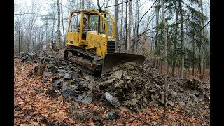 Pushing in a new driveway with a dozer