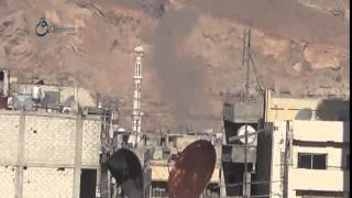 وكالة قاسيون تصاعد اعمدة الدخان نتيجة قصف قوات النظام  مدينة دوما بريف دمشق 7-12-2015