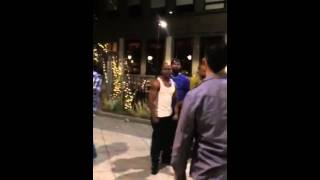 A fight between Blacks and Mexican on the street of Seattle
