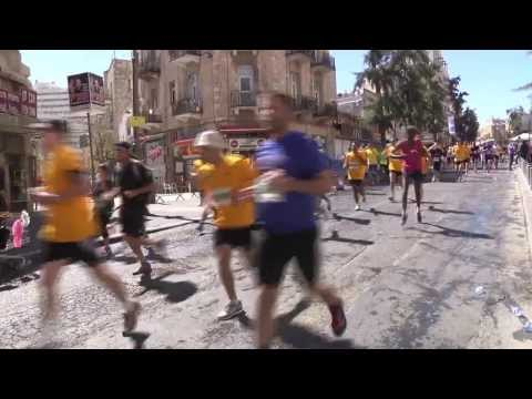 Tens of thousands of runners take to streets in Jerusalem Marathon from YouTube · Duration:  43 seconds