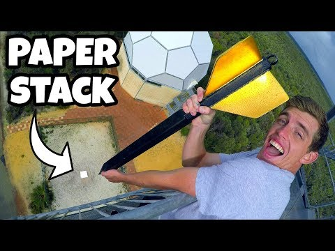 giant-dart-vs.-1500-sheets-of-paper-from-45m!