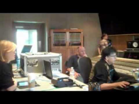 Kelly Clarkson in studio recording mistery duet