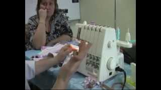 видео Швейный оверлок Merrylock 011