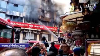 بالفيديو والصور.. 16 سيارة إطفاء للسيطرة على حريق مول تجاري و4 مخازن بالعتبة.. والأهالي غاضبون من تأخر وصول «المطافي»