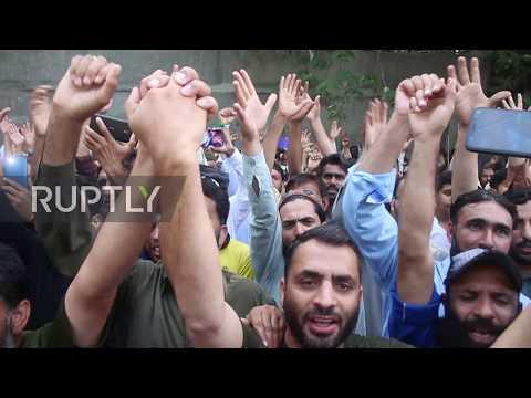 Pakistan: Hizbul Mujahideen fighters march in Muzaffarabad against India's Kashmir decision